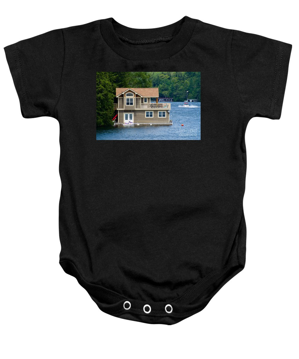 Boathouse Baby Onesie featuring the photograph Boathouses by Les Palenik