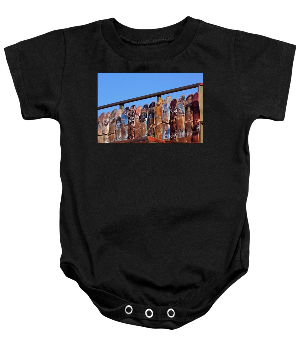 Cayucos Baby Onesie featuring the photograph Broken Skateboard Fence by Art Block Collections