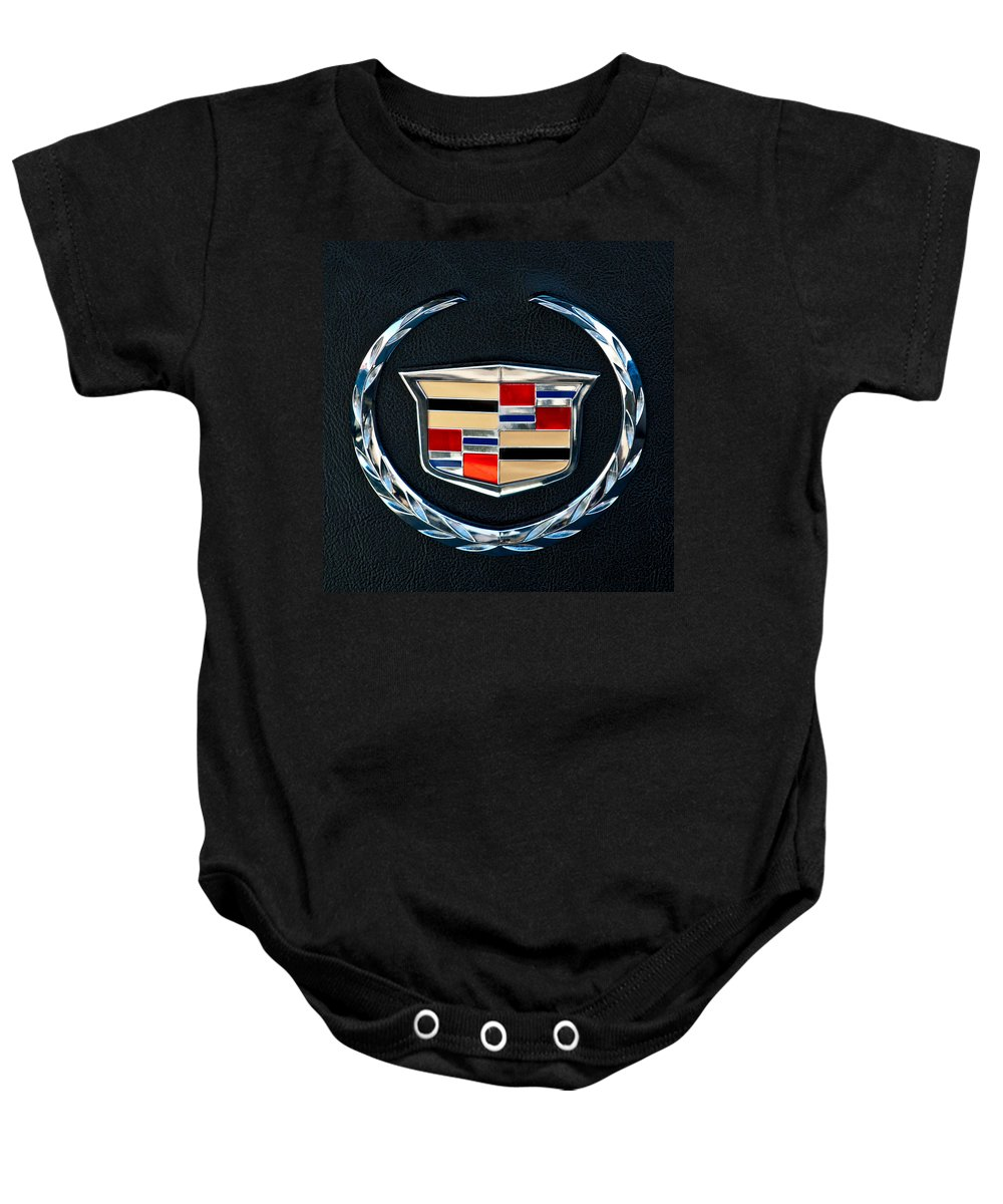 Cadillac Emblem Baby Onesie featuring the photograph Cadillac Emblem by Jill Reger