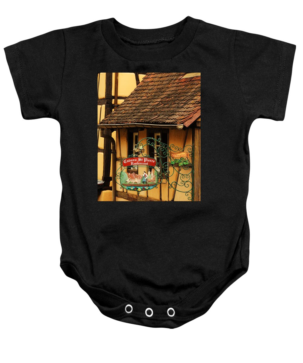 Sign Baby Onesie featuring the photograph Caveau St Pierre Sign In Colmar France by Greg Matchick