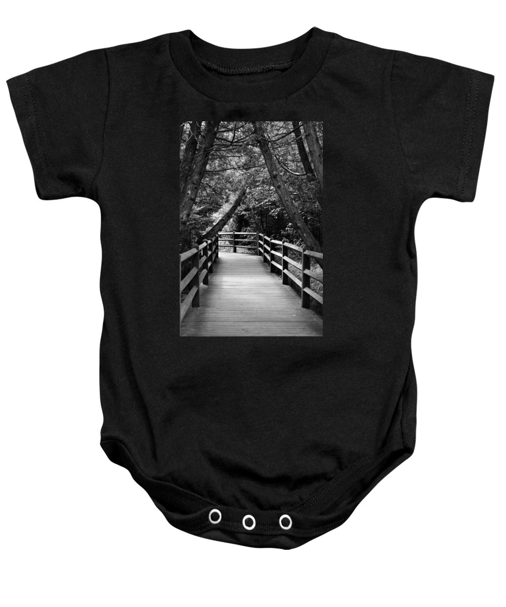 Path Baby Onesie featuring the photograph Cedar Pathway by Michelle Calkins