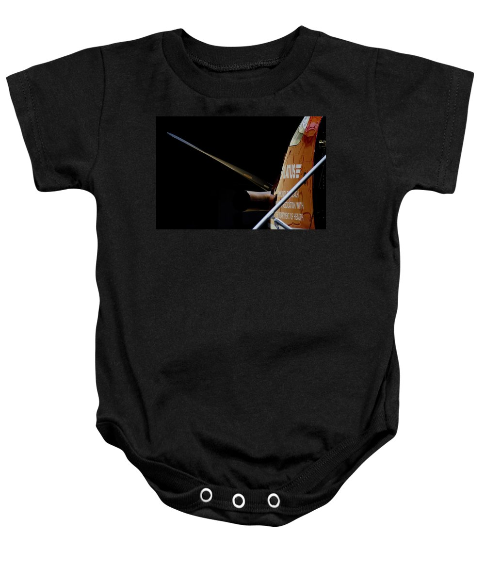 Pilatus Pc 12 Baby Onesie featuring the photograph Cold Start by Paul Job