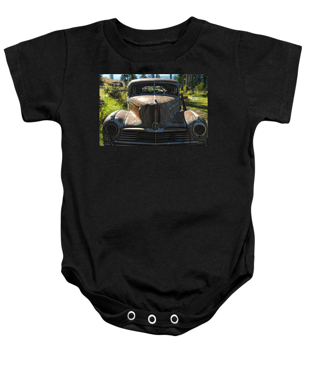 Car Baby Onesie featuring the photograph Discarded Love by Donna Blackhall