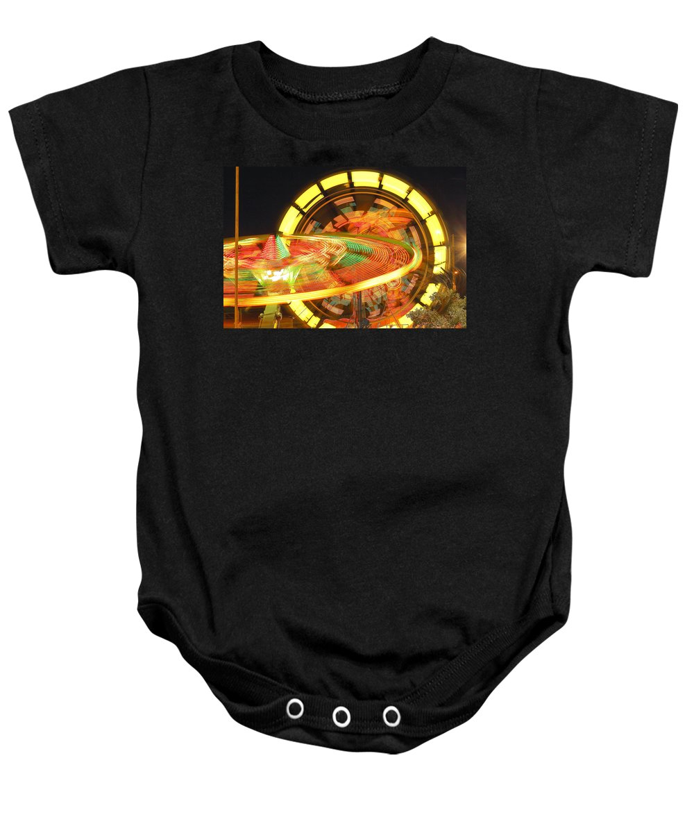 Carnival Baby Onesie featuring the photograph Dizzy by Ken Kobe