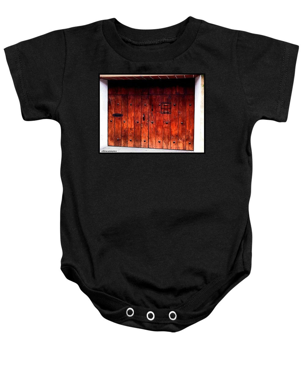 Old Doors Baby Onesie featuring the photograph Double Studded Wood Doors by Ellen Cannon
