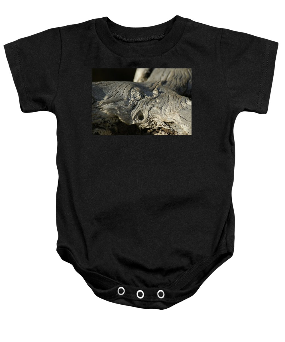 Driftwood Baby Onesie featuring the photograph Driftwood by Evelyn Hill