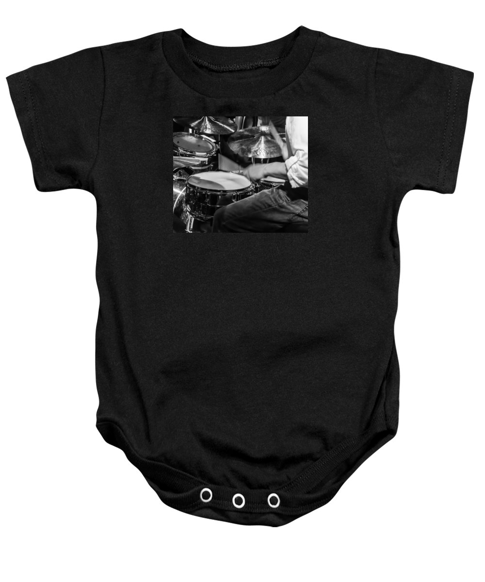 Drum Set Baby Onesie featuring the photograph Drummer At Work by Photographic Arts And Design Studio