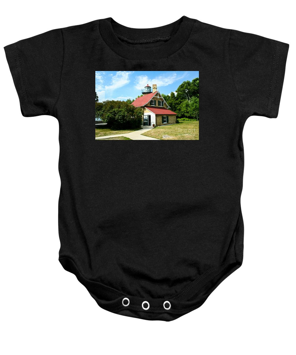 Eagle Bluff Baby Onesie featuring the photograph Eagle Bluff Lighthouse by Tommy Anderson