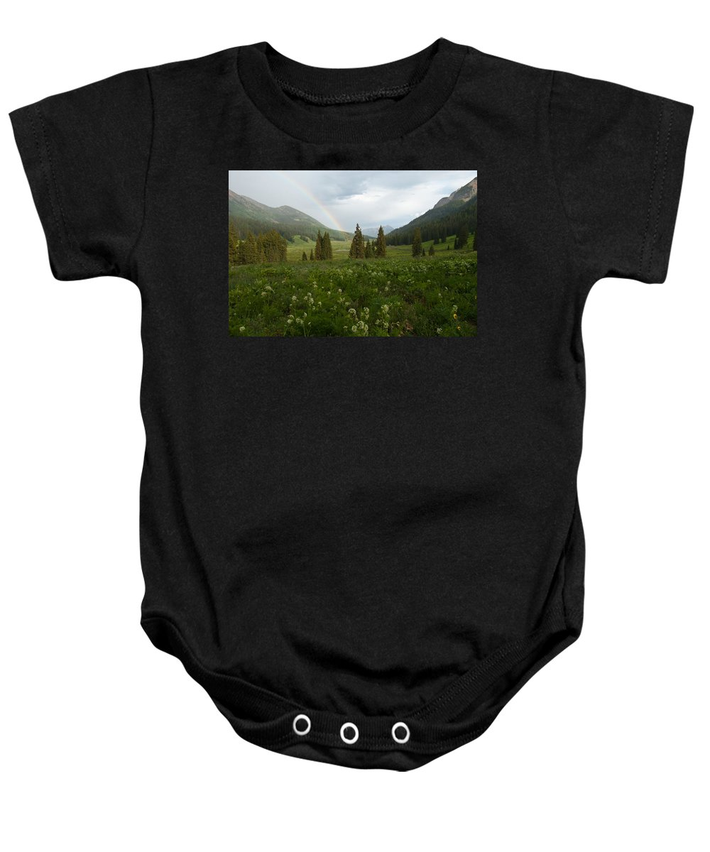 Rainbow Baby Onesie featuring the photograph Evening Rainbow In The Rocky Mountains by Cascade Colors