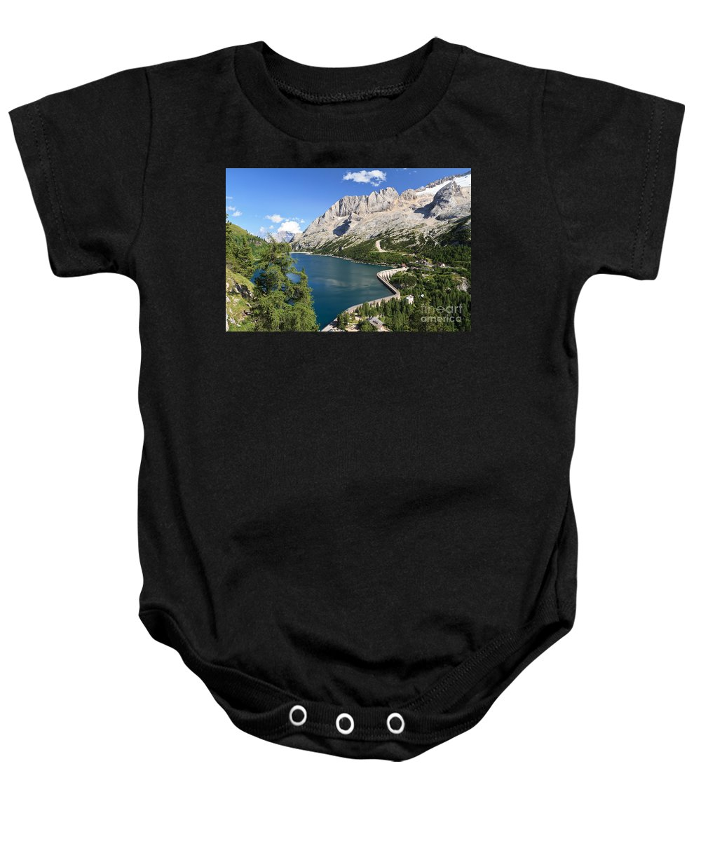 Alpine Baby Onesie featuring the photograph Fedaia Pass With Lake by Antonio Scarpi