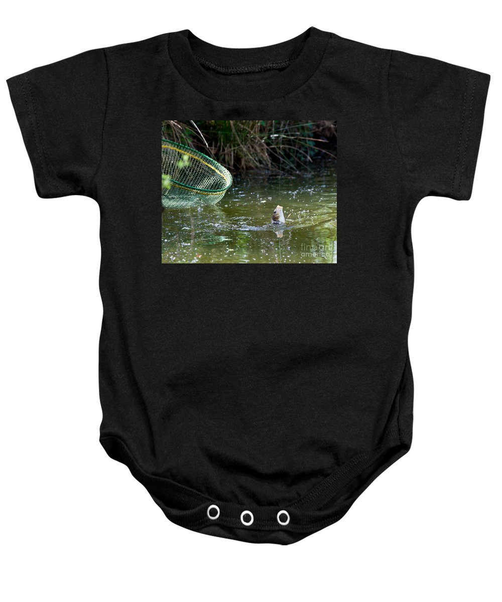 Fish Baby Onesie featuring the photograph Fish Caught On A Line In Water by Simon Bratt Photography LRPS