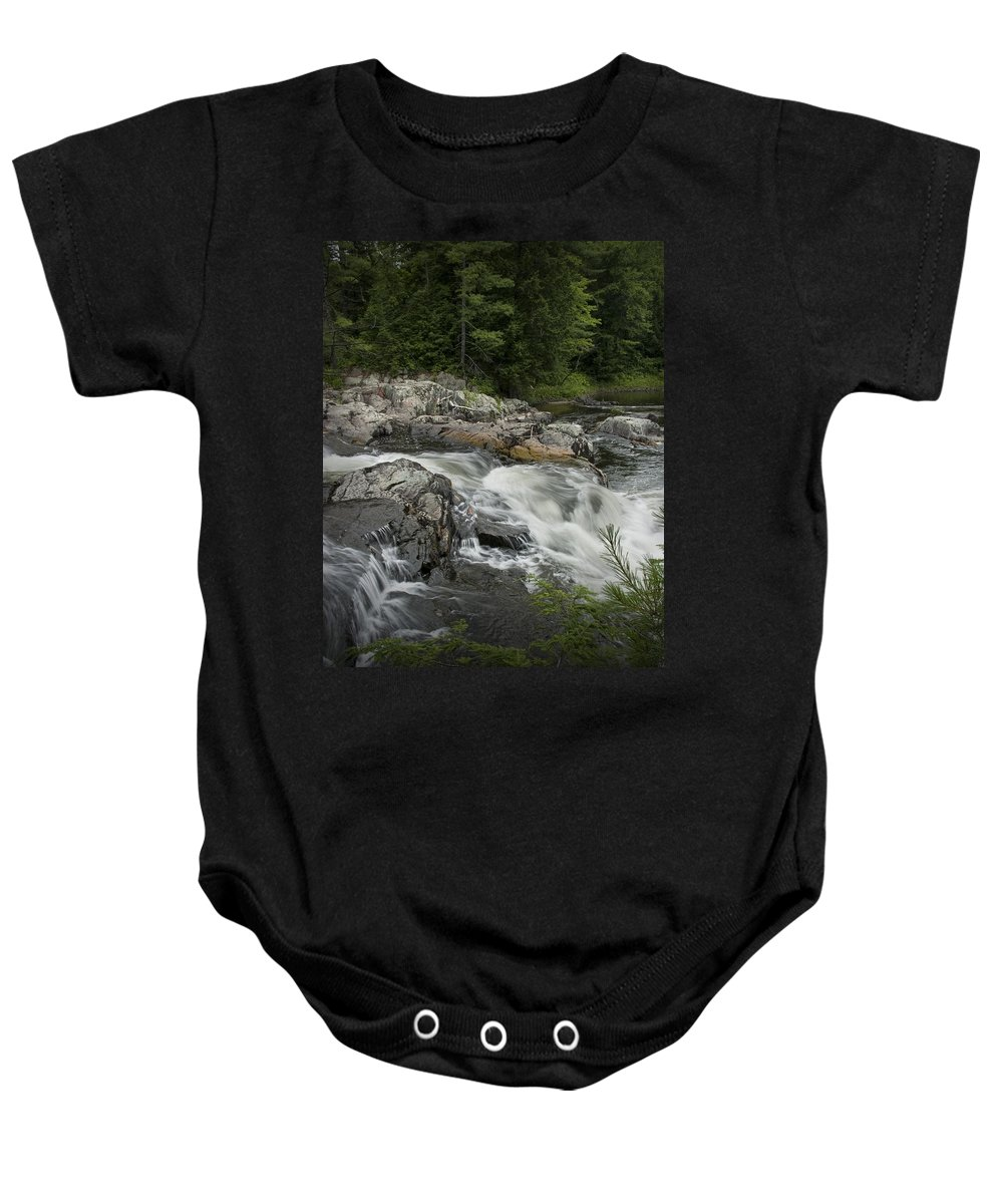 Art Baby Onesie featuring the photograph Flowing Stream With Waterfall In Vermont by Randall Nyhof