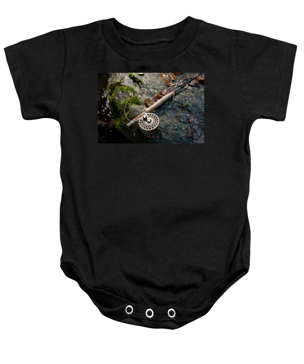 Banner Elk Baby Onesie featuring the photograph Fly Rod And Reel Detail On Mossy Wet by Tommy Penick