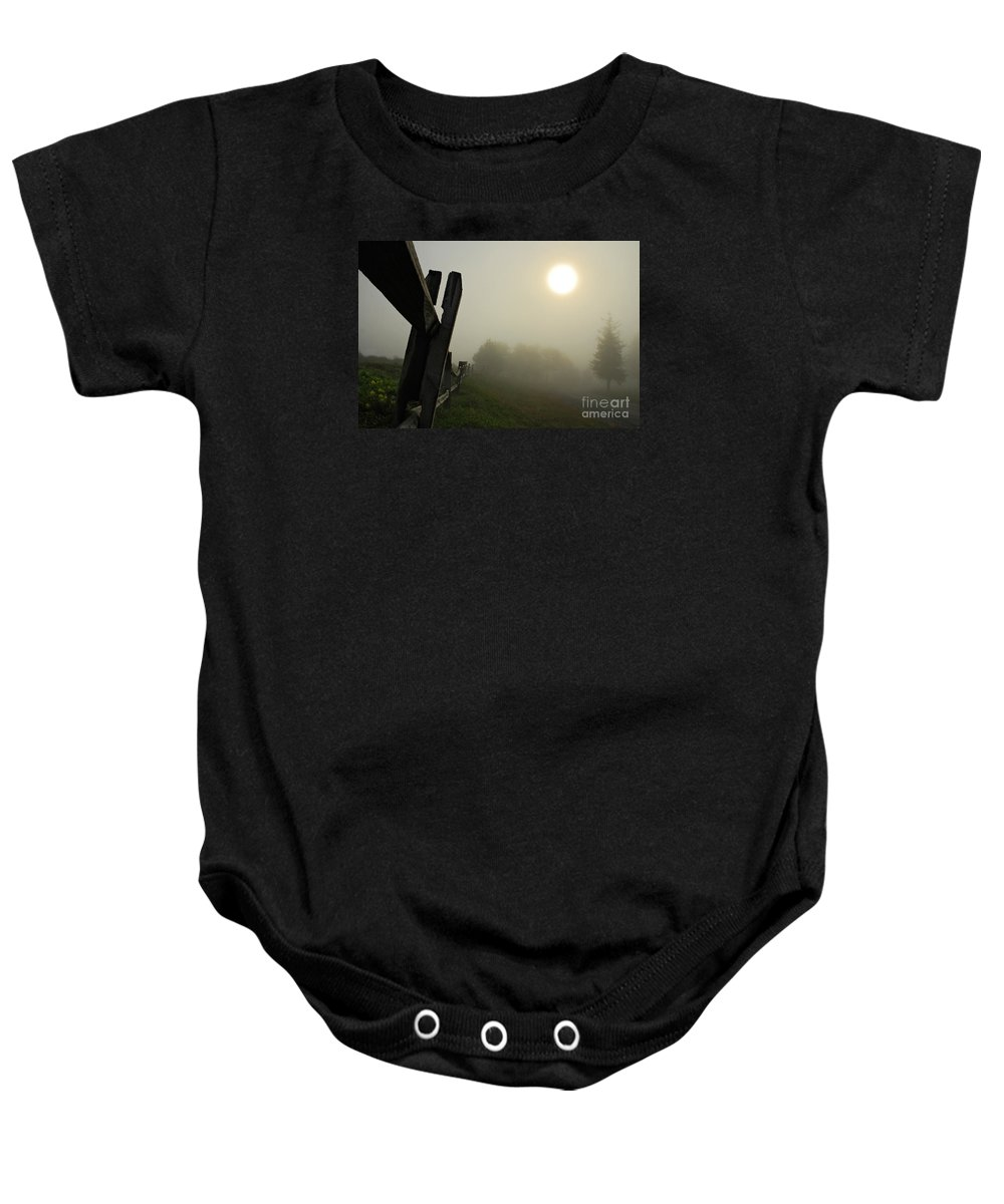 Foggy Country Road Baby Onesie featuring the photograph Foggy Country Road by Lois Bryan