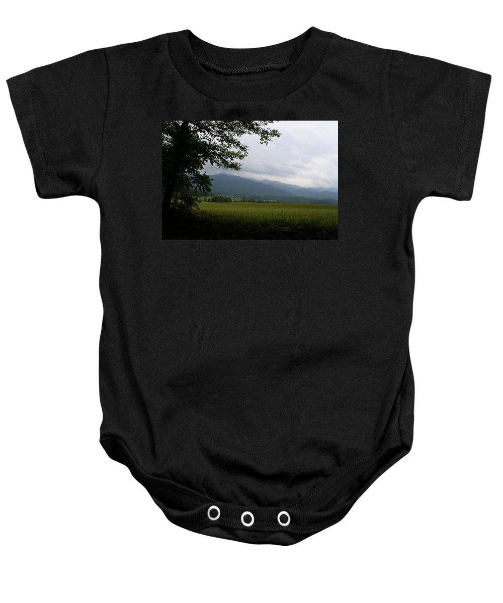 Cades Cove Baby Onesie featuring the photograph From The Shadows by Dan McCafferty