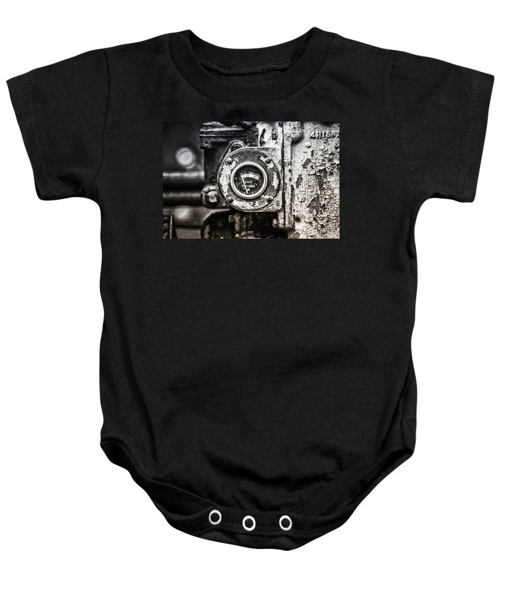 Caterpillar Bulldozer Baby Onesie featuring the photograph Fuel Deficient by Susan Capuano