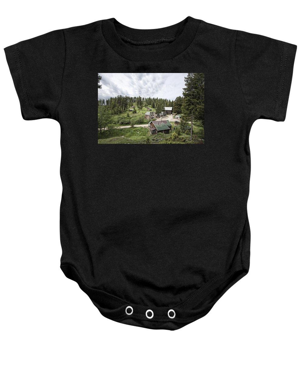 Garnet Baby Onesie featuring the photograph Garnet Ghost Town - Montana by Daniel Hagerman