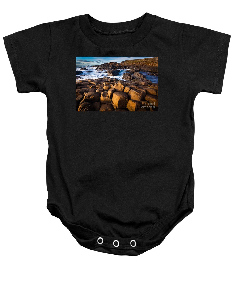 Europe Baby Onesie featuring the photograph Giant's Causeway Surf by Inge Johnsson