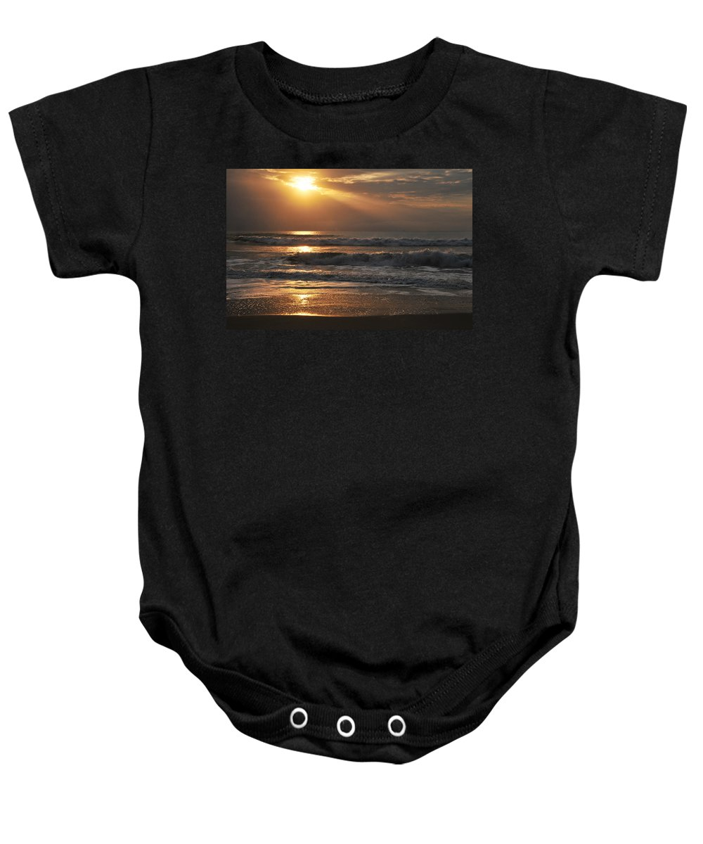 Sunset Baby Onesie featuring the photograph God's Rays by Lynn Bauer