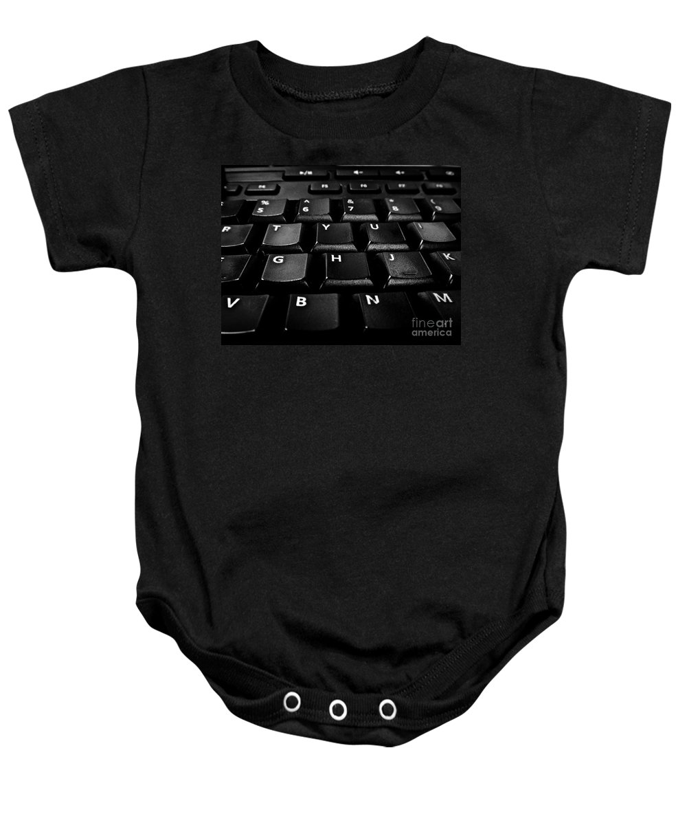 Black And White Photography Baby Onesie featuring the photograph Gotta Go by Fei A