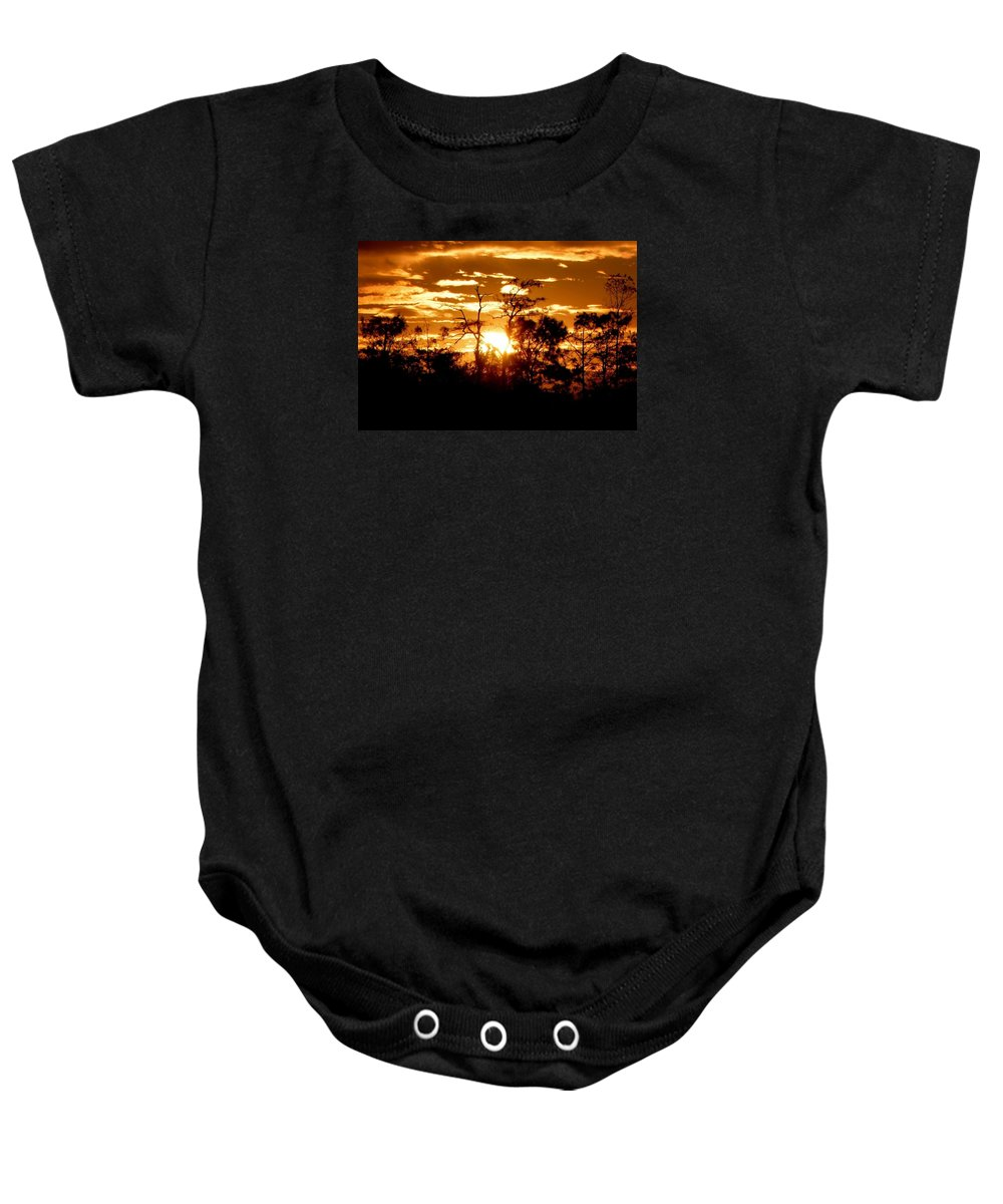 Florida Everglades Baby Onesie featuring the photograph Here Comes The Sun by Mitch Caueffield