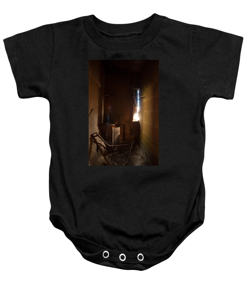 Montana Baby Onesie featuring the photograph Hidden In Shadow by Fran Riley