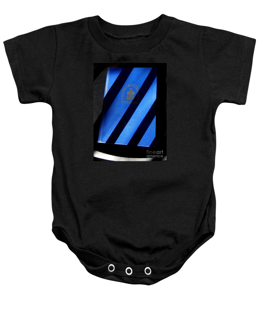 Hymnal Baby Onesie featuring the photograph Hymnal In Shadows by Ed Weidman