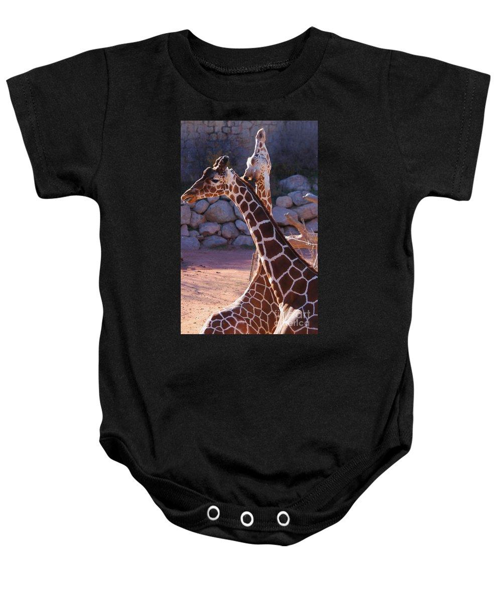 Giraffe Baby Onesie featuring the photograph I'm Not Listening by Tonya Hance