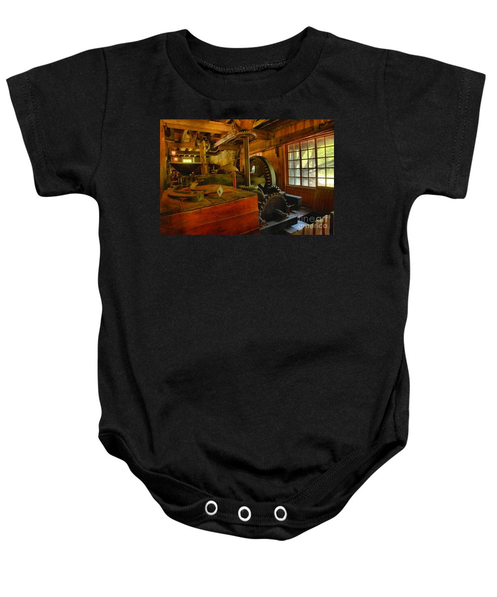Grist Mill Gears Baby Onesie featuring the photograph Inside A Grist Mill by Adam Jewell