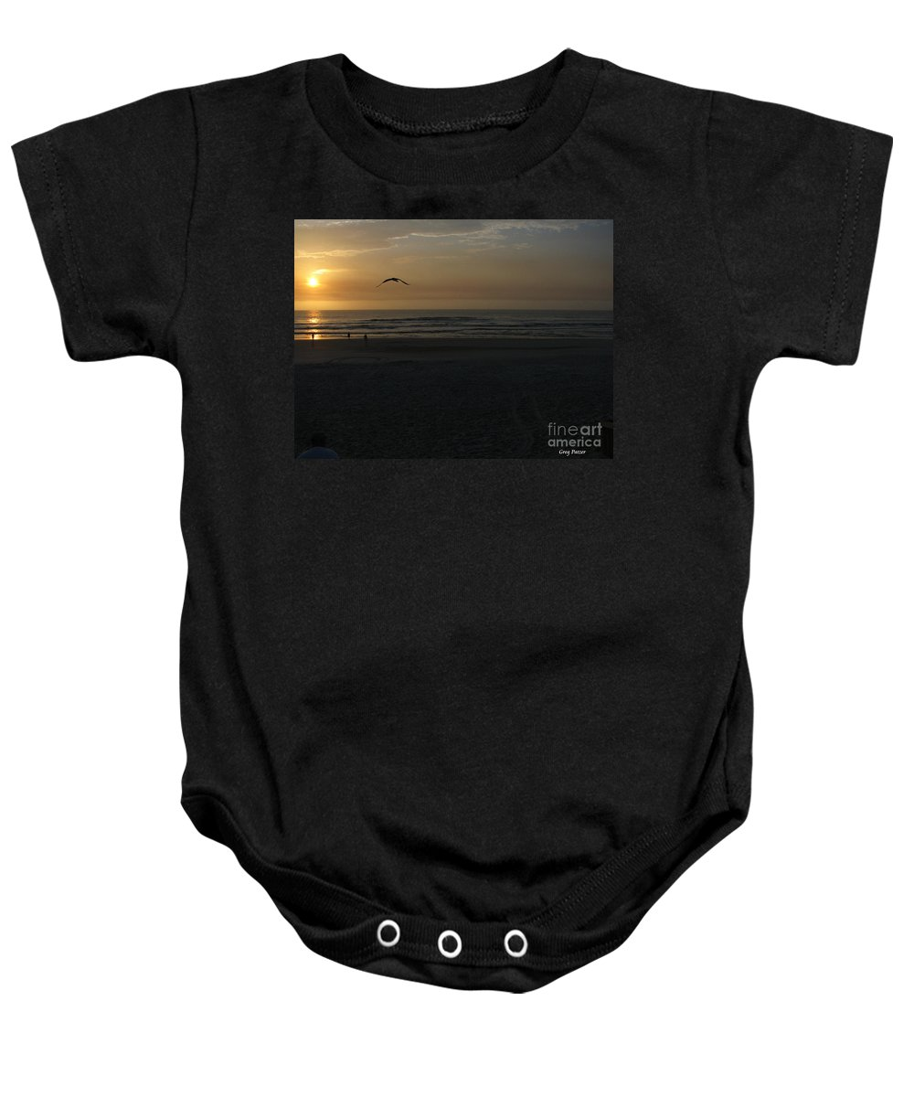 Florida Sunrise Baby Onesie featuring the photograph It Starts by Greg Patzer