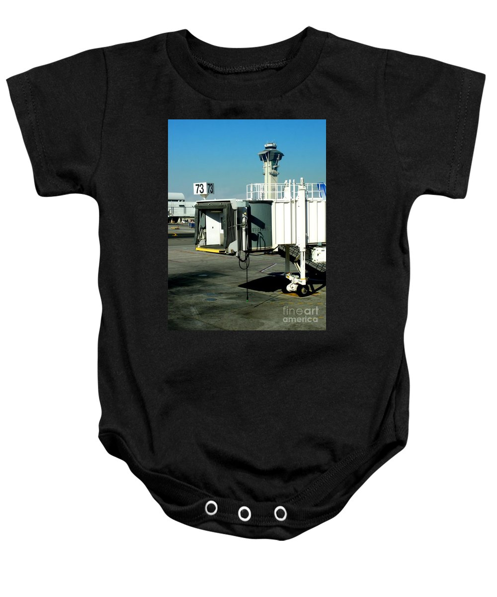 Transportation Baby Onesie featuring the photograph Jetway by Henrik Lehnerer