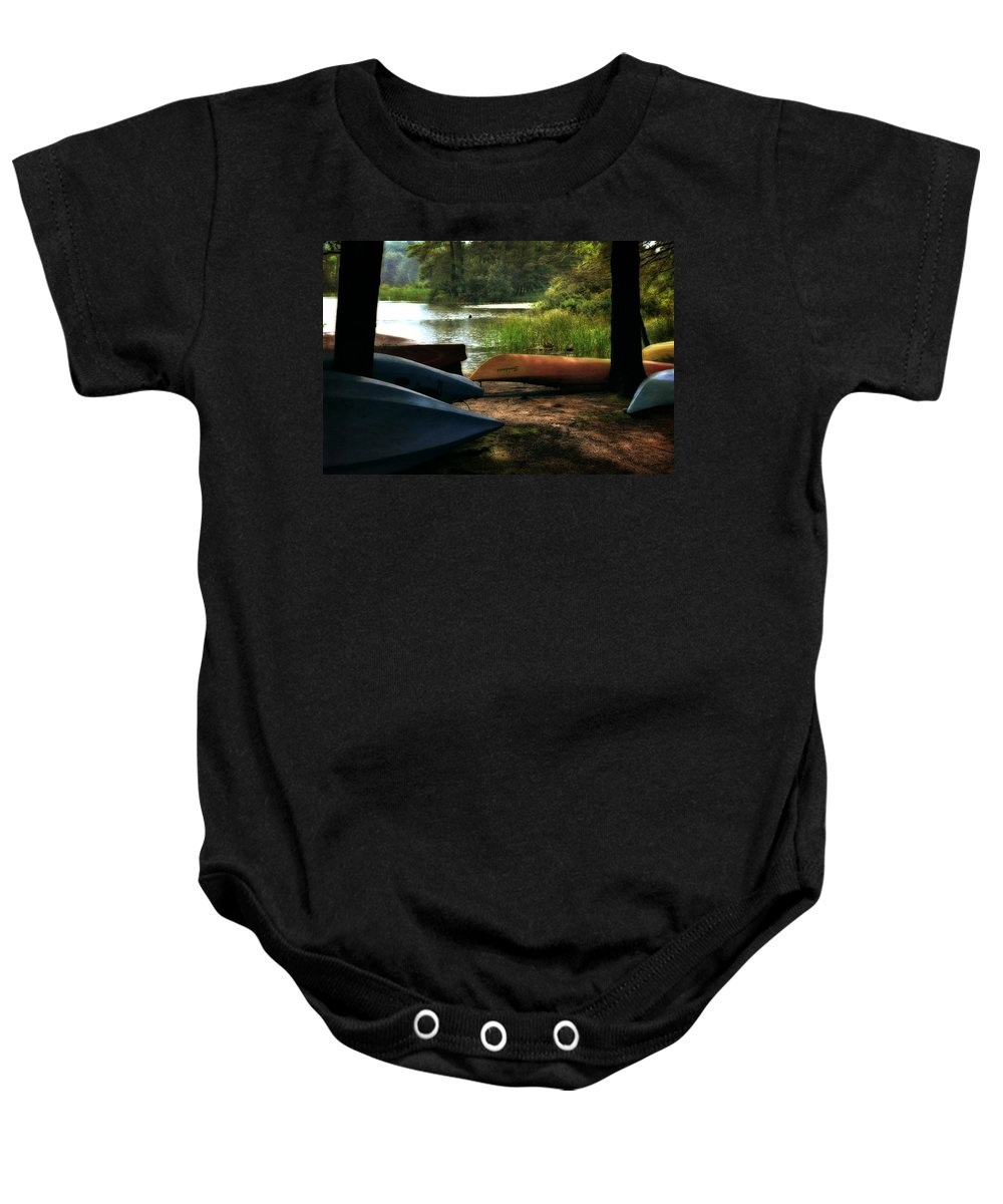 Kayak Baby Onesie featuring the photograph Kayaks On The Shore by Michelle Calkins