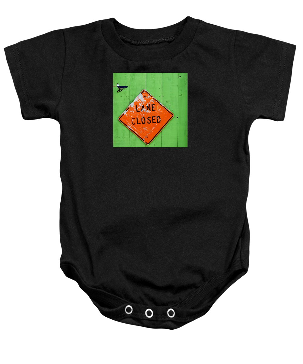 Sign Baby Onesie featuring the photograph Lane Closed by Art Block Collections