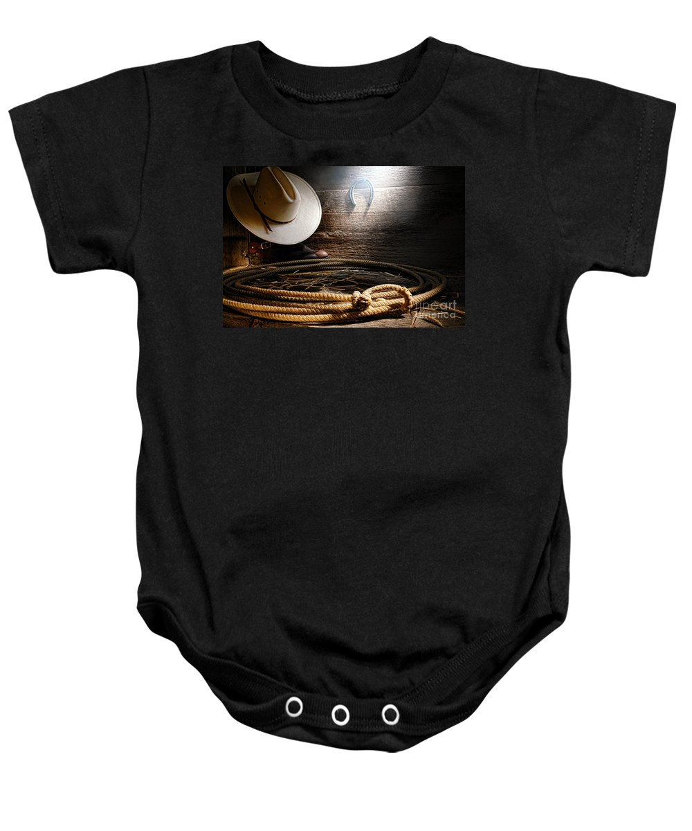 Western Baby Onesie featuring the photograph Lasso In Old Barn by Olivier Le Queinec