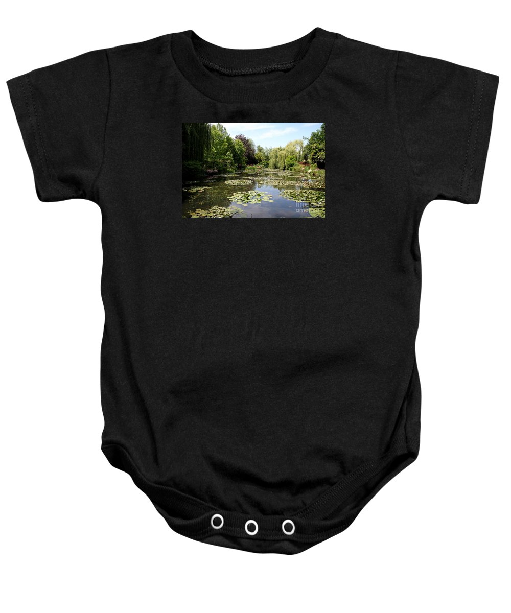 Claude Monet Baby Onesie featuring the photograph Lilypond Monets Garden by Christiane Schulze Art And Photography