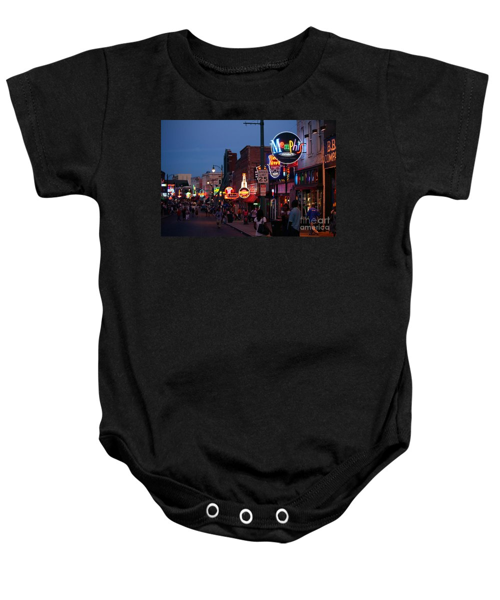 Skyline Scenes Baby Onesie featuring the photograph Looking Down Beale Street Memphis by Bill Cobb