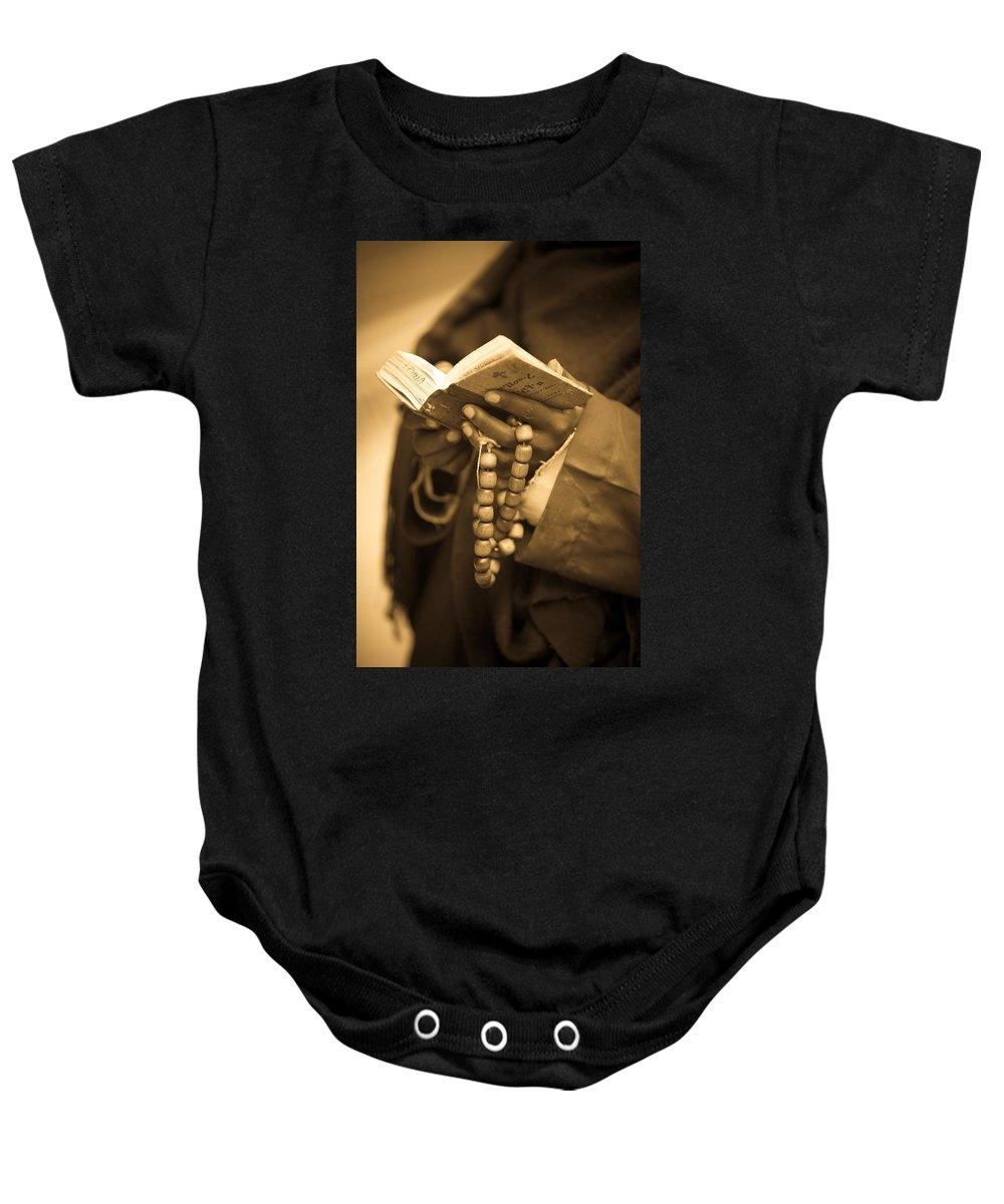 African Culture Baby Onesie featuring the photograph Man Holding Prayer Book Ethiopia by David DuChemin