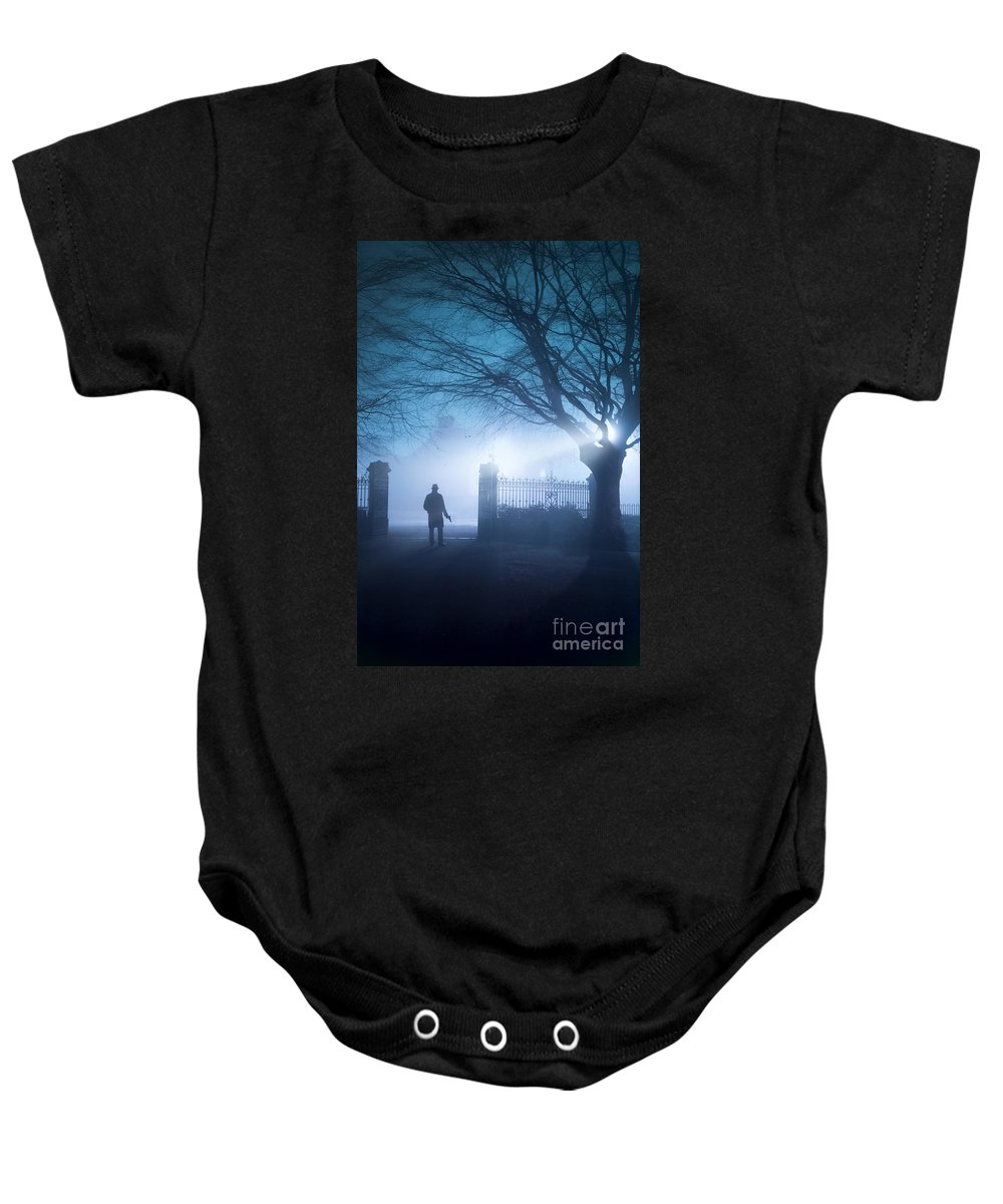 Man Baby Onesie featuring the photograph Man Standing In Foggy Gateway At Night by Lee Avison