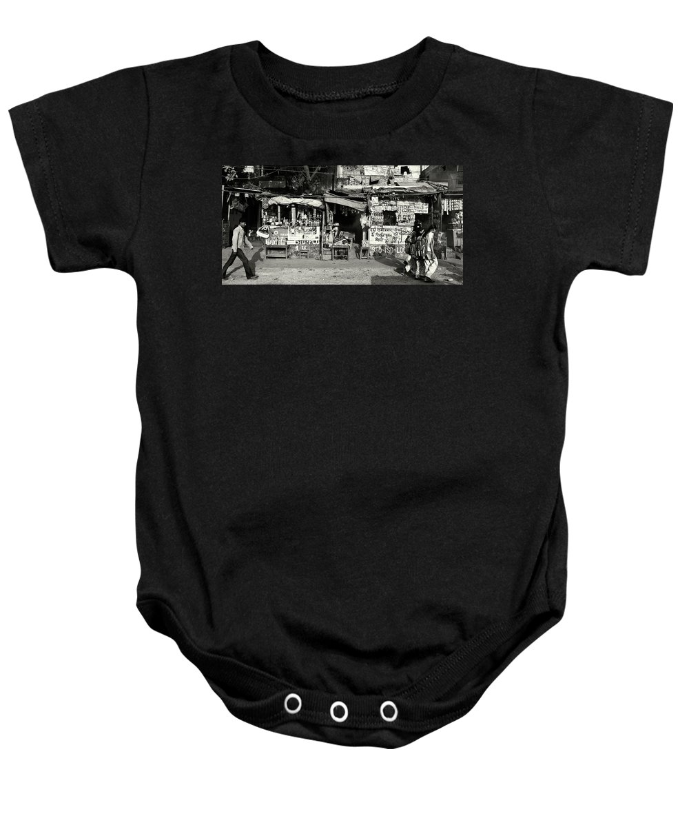 Travel Baby Onesie featuring the photograph Man Woman And Schoolgirls by Roberto Pagani