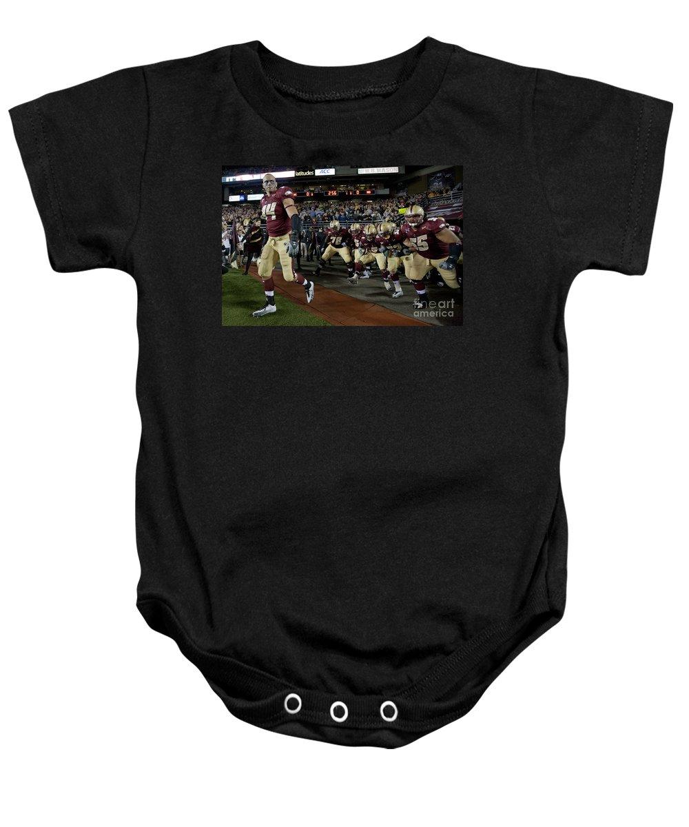 Sports Equipment Baby Onesie featuring the photograph Mark Herzlich by Jason O Watson