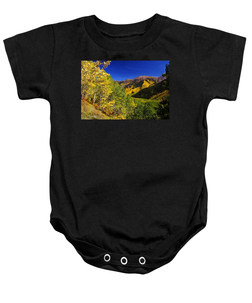Colorado Baby Onesie featuring the photograph Maroon And Gold by Jeremy Rhoades