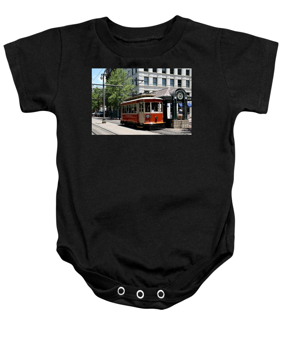 Mata Baby Onesie featuring the photograph Memphis Trolley On Main Street by Bill Cobb