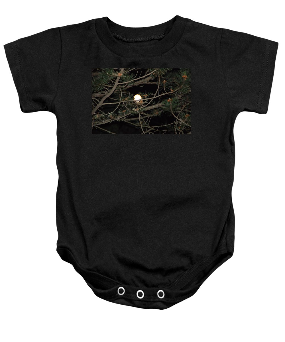 Moon Baby Onesie featuring the photograph Moon Through Pines by Aimee L Maher ALM GALLERY