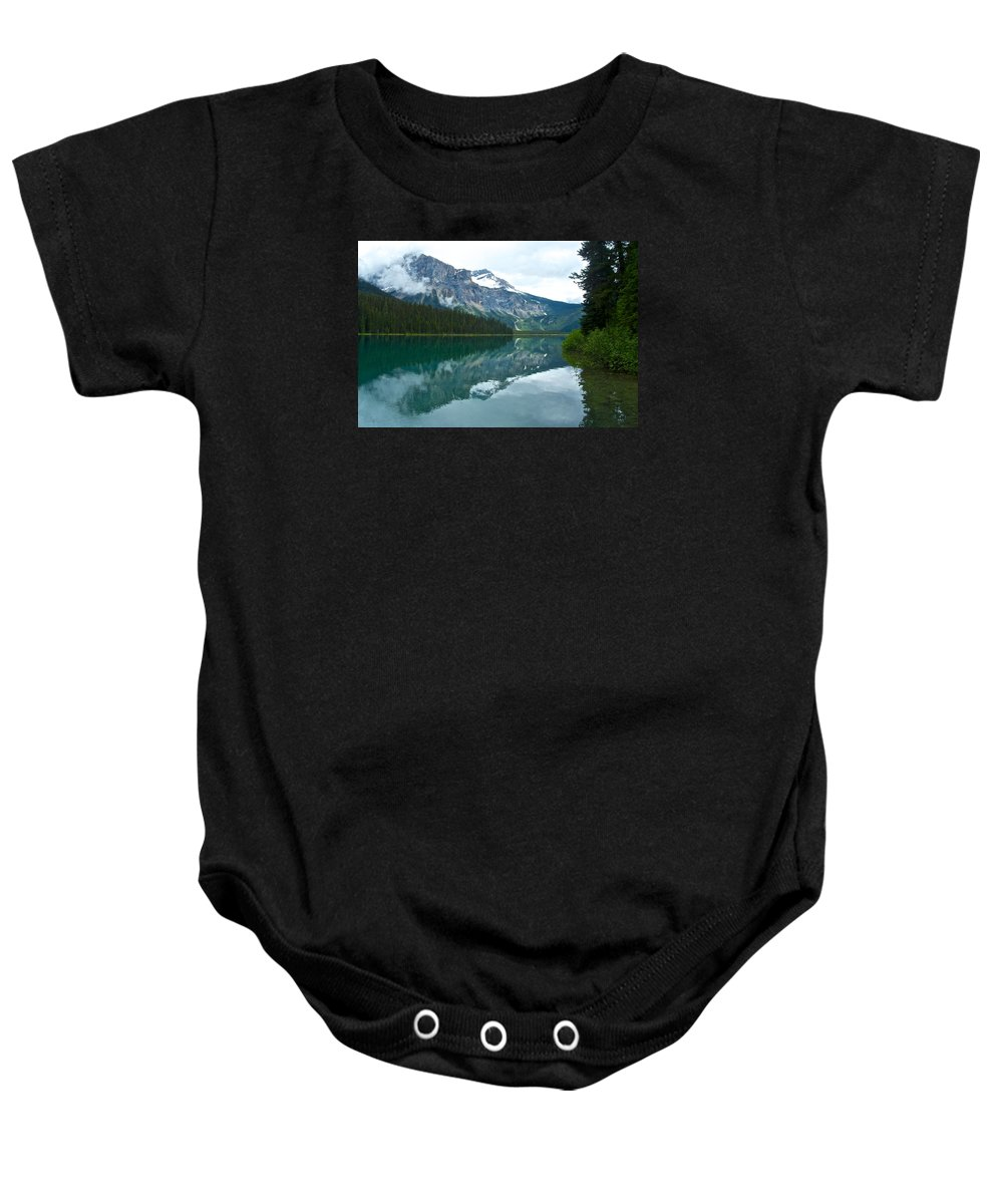Morning Reflection In Emerald Lake From Trail In Yoho Np Baby Onesie featuring the photograph Morning Reflection In Emerald Lake In Yoho National Park-british Columbia-canada by Ruth Hager