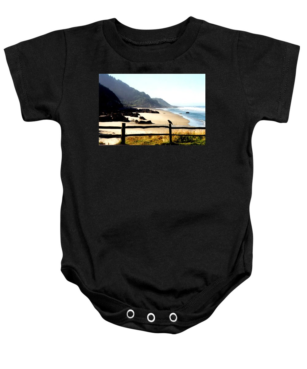 Oregon Coast Baby Onesie featuring the photograph Neptune Beach Crow by Loren McNamara