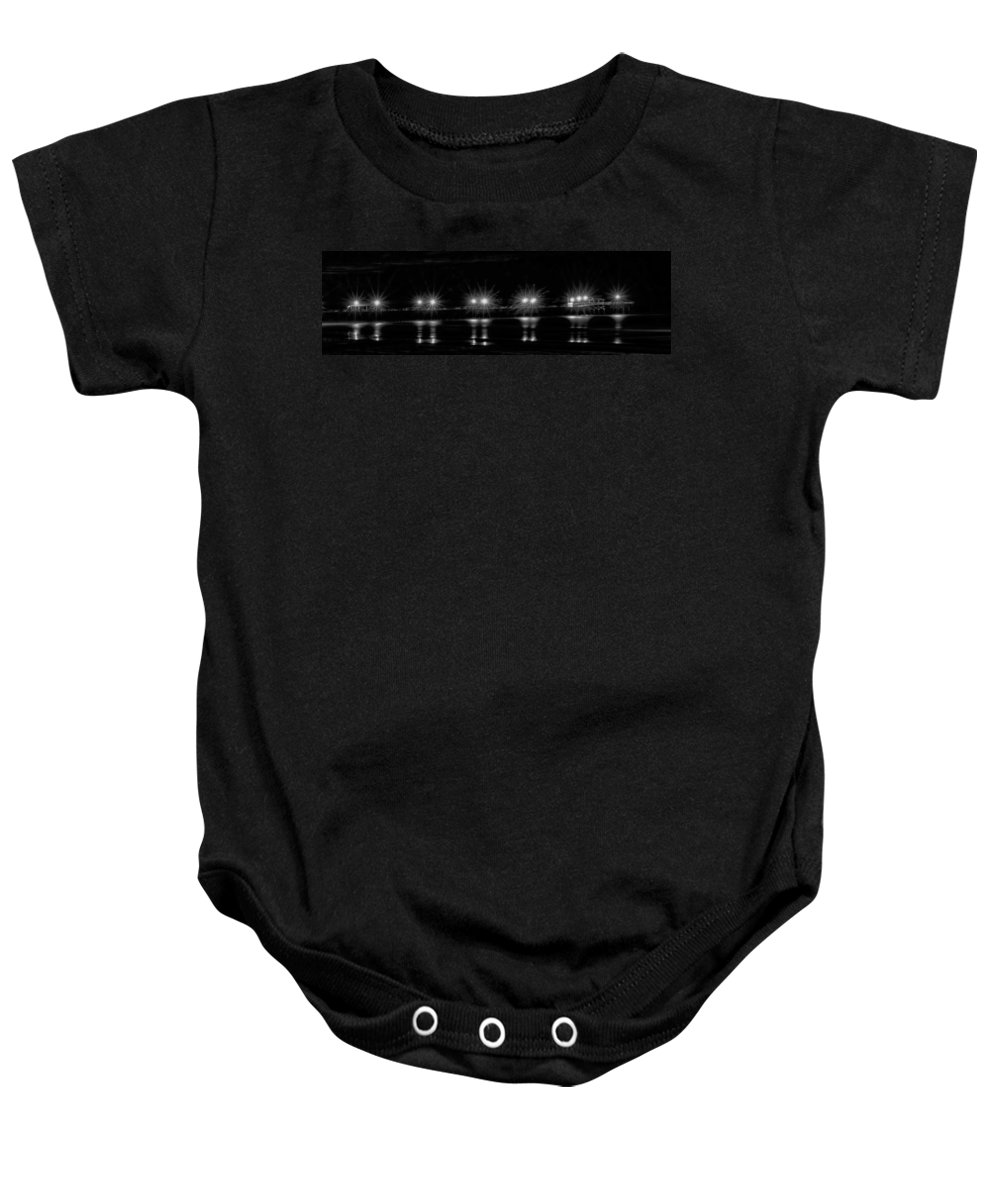 Night Baby Onesie featuring the photograph Night Pier Black And White by Photos By Cassandra