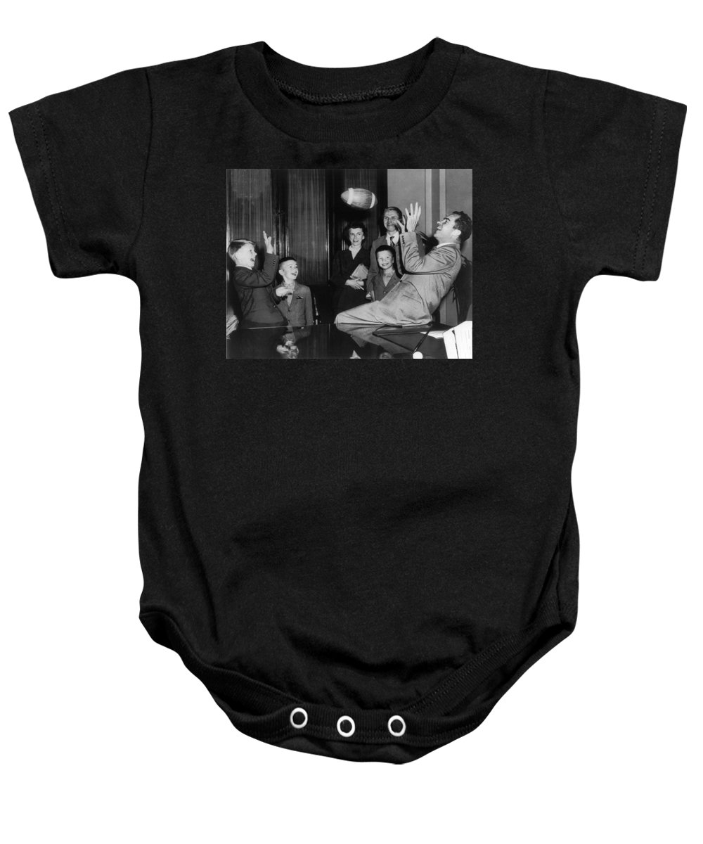 1950 Baby Onesie featuring the photograph Nixon Catching Football by Underwood Archives