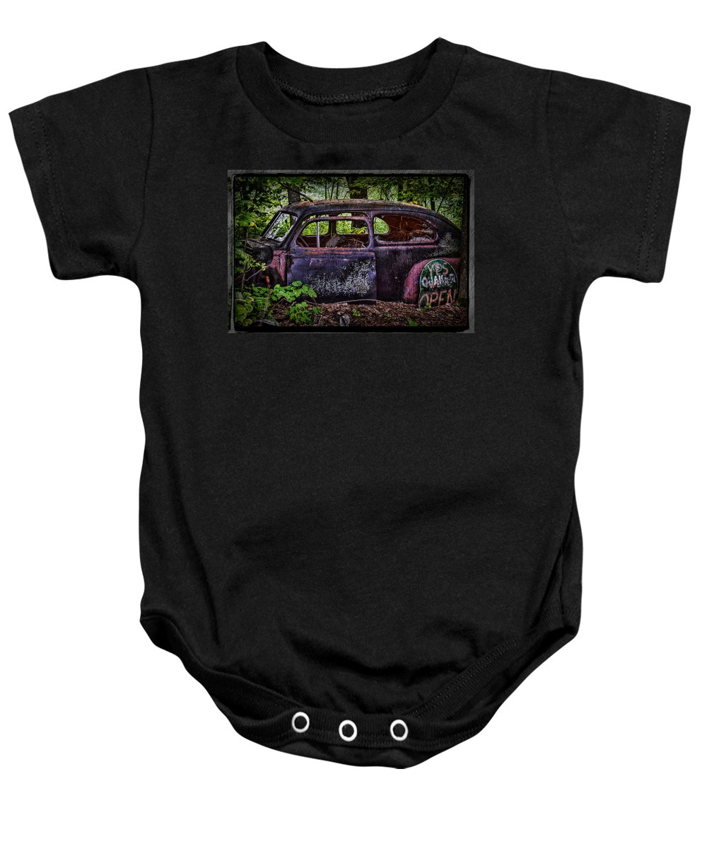 Old Car Baby Onesie featuring the photograph Old Abandoned Car In The Woods by Paul Freidlund
