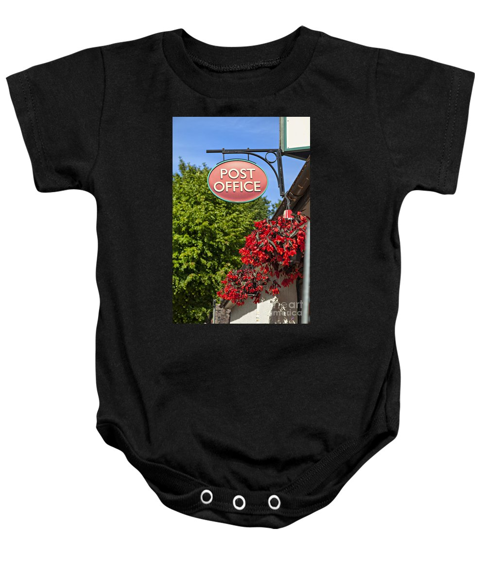 Flowers Baby Onesie featuring the photograph Old Fashioned Post Office Sign by Sophie McAulay