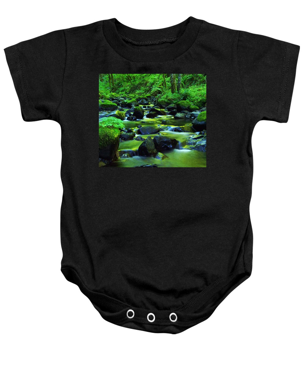 Oregon Streams Baby Onesie featuring the photograph On Golden Waters by Jeff Swan